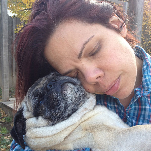 A woman with a pug.