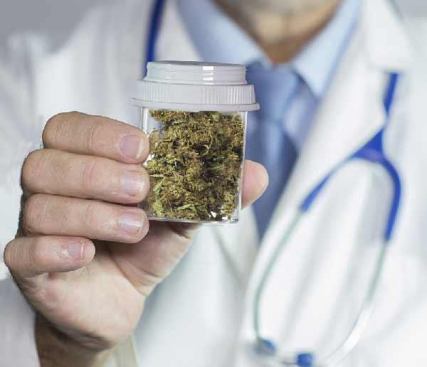 Doctor offering medical marijuana by Shutterstock