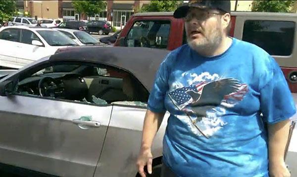 Michael Hammons in front of the car. (Screenshot: WAGA)
