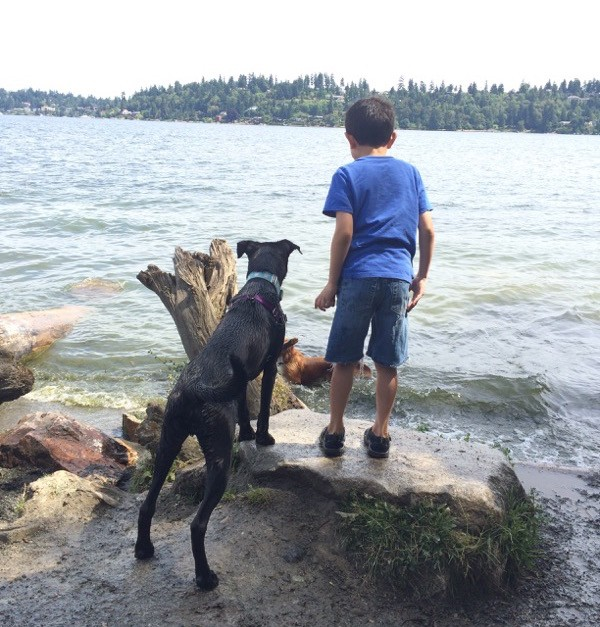 My son Justin with our dog Magnum at the dog park. Photo by Kezia Wilingham.