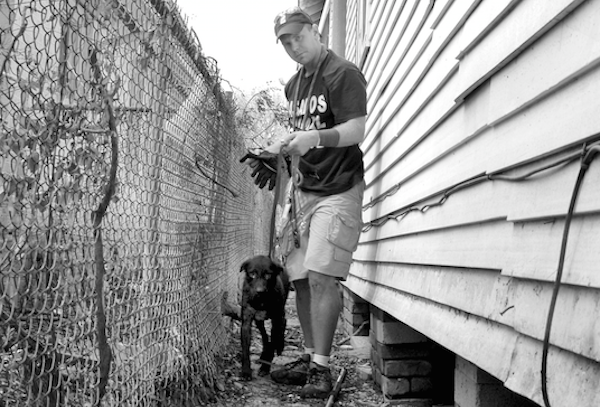 One of Steve's first Hurricane Katrina rescues was this female dog he found hiding under a house. She was very happy to see him! (Photo courtesy Steve