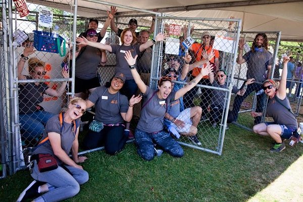 Volunteers and staff of Best Friends Animal Society - Los Angeles, who use an policy, celebrate empty shelter kennels at an adoption event. (Photo courtesy of Best Friends Animal Society's Facebook Page.)