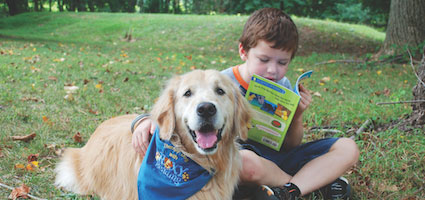 A Roxy Reading Therapy Dog at work. (Photo courtesy Roxy Reading Therapy Dogs)