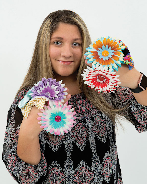 Isabella Masso of Isabella's Pet Shop bows. (Photo by Chris Savas)
