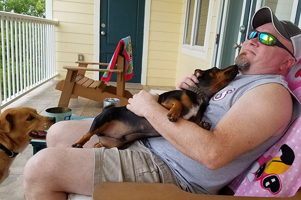 """Michael and his dogs"" -Submitted by Facebook user Cora Turner"
