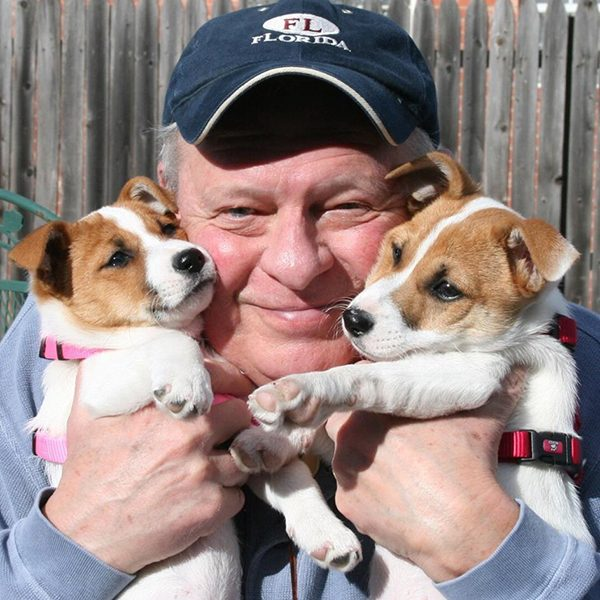 """My Jim with our fur babies Zuzu and Bailey."" -Submitted by Facebook user Janelle Hastings"
