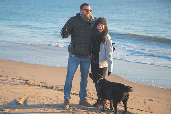 Dog lovers on a Virginia Beach.