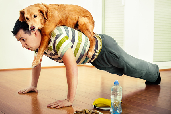 A Man Doing Pushups Exercises With His Dog