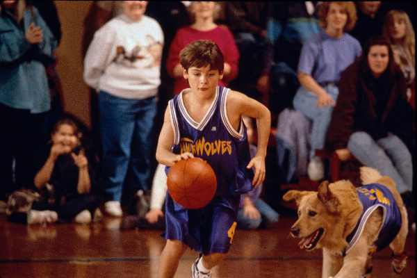 Actor KEVIN ZEGERS as Josh Framm and Buddy The Dog in 'Air Bud.'