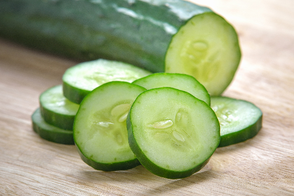 Sliced up cucumbers.