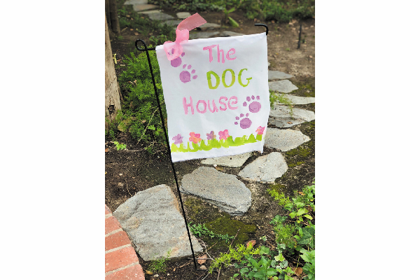 Dog-themed garden flag.
