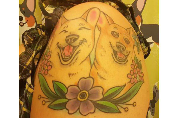 Rae's dog tattoo.