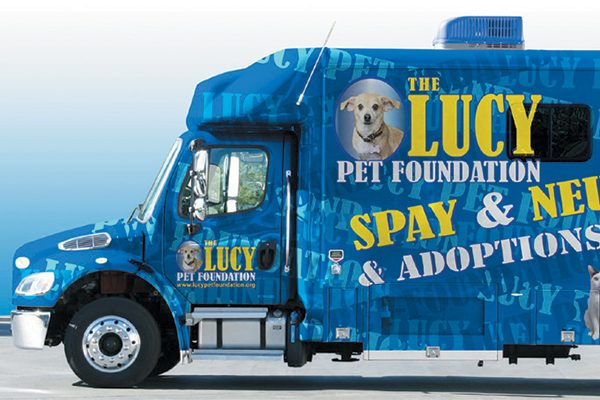 The Lucy Pet Foundation mobile truck with dogs pictured on the side on the truck.