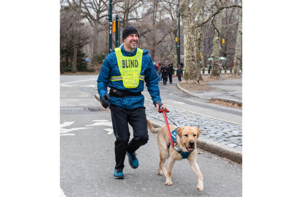 Accomplished distance runner and President/CEO of Guiding Eyes for the Blind Thomas Panek to run the United Airlines NYC Half marathon with several running guide dogs, including yellow Labrador Retriever Yukon.