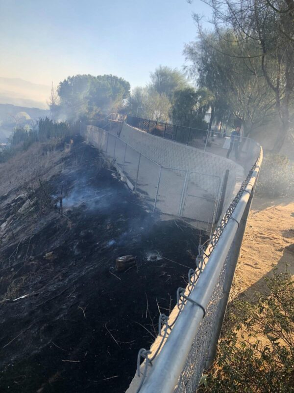 """The charred and burning ground reached all the way up the fences of our play-yard and our Clinic, only a few feet away from our building,"" says the email the Mary S. Roberts Pet Adoption Center in Riverside, California, sent out to its volunteers. Courtesy PAC."